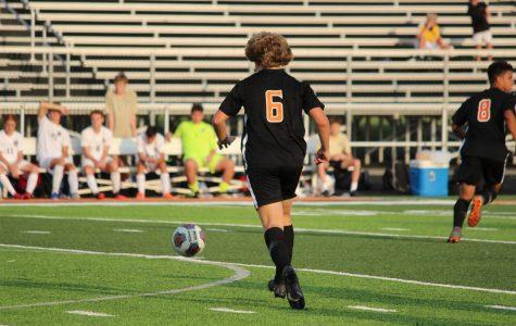 Sam Cairns running after the ball