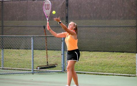 Rileigh Stevens shows her form as she serves the ball.