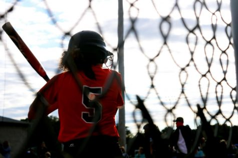 Varsity softball player, Lizzy Turk, preparing for her up at bat.