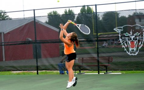 Emily Ford practices serving before her first match