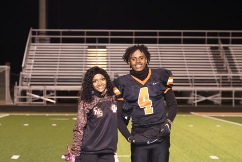 Cheerleading candidates, Takyra Williams and Elijah Wigfall, smile just prior to being crowned homecoming king and queen.