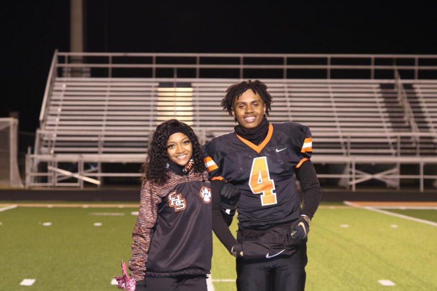 Cheerleading+candidates%2C+Takyra+Williams+and+Elijah+Wigfall%2C+smile+just+prior+to+being+crowned+homecoming+king+and+queen.+