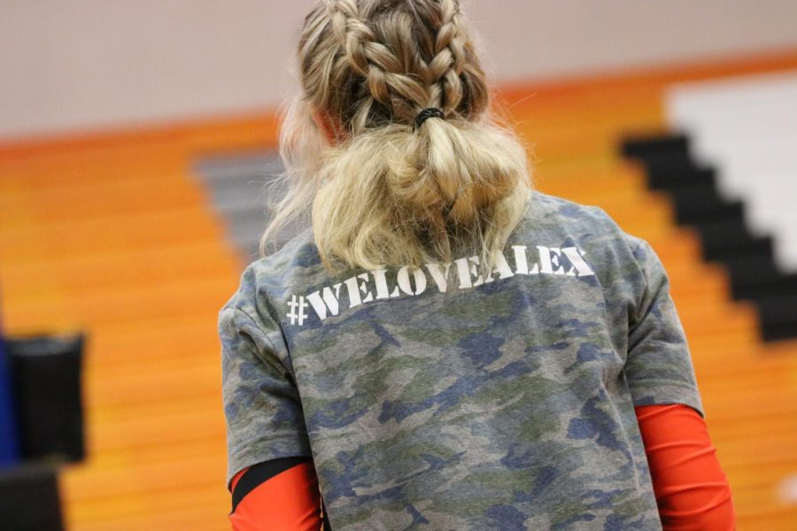 Maddie Thomas (12) watches as the Tigers warm up.